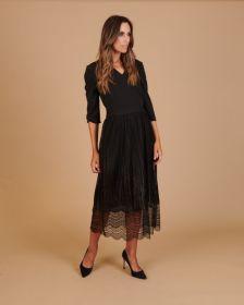 Zwart kleed in verschillende stoffen Linea Raffaelli
