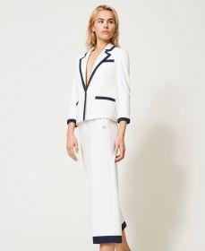 Witte broek met blauwe boord
